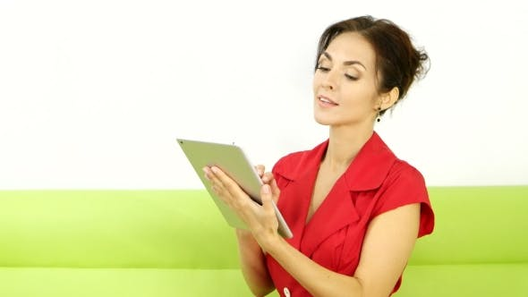 Thumbnail for Young Girl With Tablet Pc on the Sofa