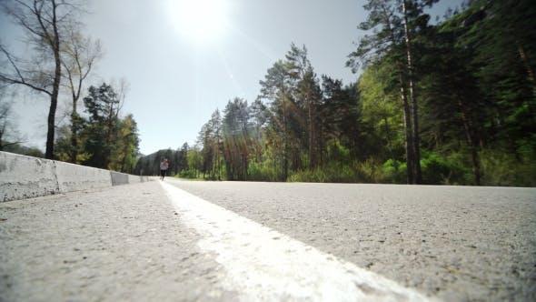 Thumbnail for Female Runner Jogging On Mountain Road Training For Marathon.