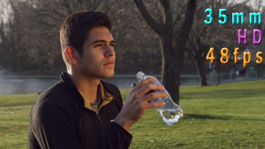 Man Drinking Water From the Bottle Outdoors 12