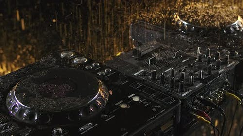 Party Dj Sound mixer.Crossfader Volume Regulator Knobs on Mixing Controller for DJ. Raindrops in
