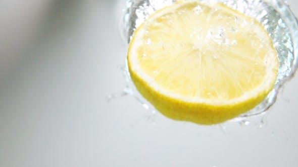Thumbnail for Half Lemon Drop Down Into Water