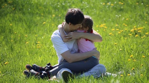 Father Hugging Daughter