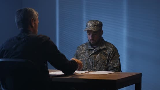 Thumbnail for Expressive Policeman Examining Military Man in Interview Room
