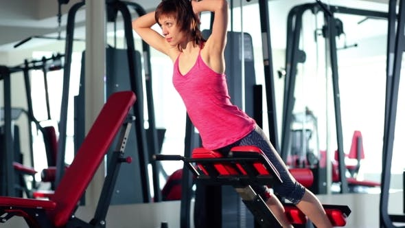 Thumbnail for Young Woman Doing Exercise For Back At The Gym