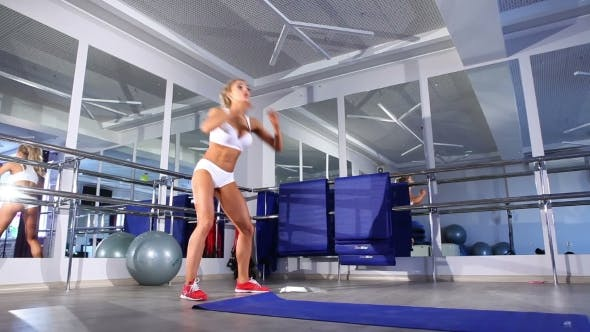 Thumbnail for Woman  Warming Up For Exercising In a Gym