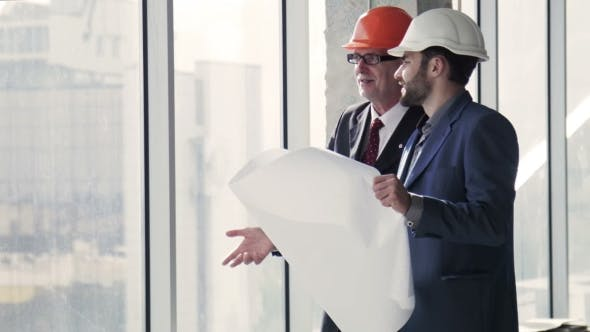 Thumbnail for Architects Talking With Building Plan In Hands