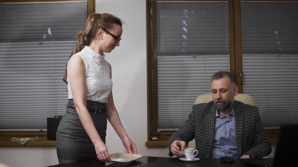 Cover Image for Young Secretary Servicing The Coffee To Her Handsome Boss