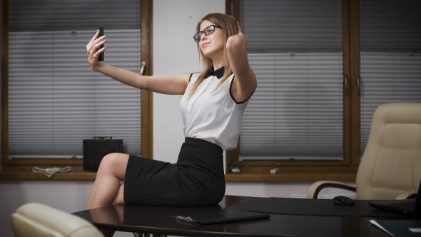 Cover Image for Happy Businesswoman Making Selfie Photo In Office