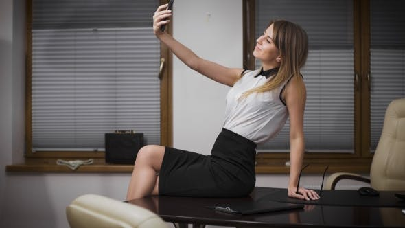 Thumbnail for Happy Businesswoman Making Selfie Photo In Office