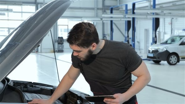 mechanic records car problems to the tablet by kotlyarn on envato