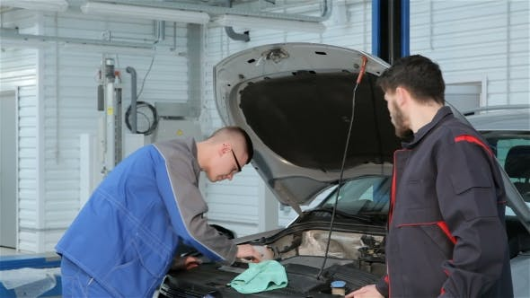 Thumbnail for Mechanic Troubleshoots Car Problem At The Car Service