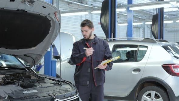 Thumbnail for Mechanic Examines Car At The Service