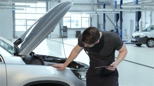 Thumbnail for Mechanic Examines Car Fender