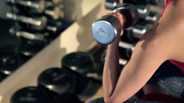 Thumbnail for Woman Doing Exercise With Barbell In The Gym.