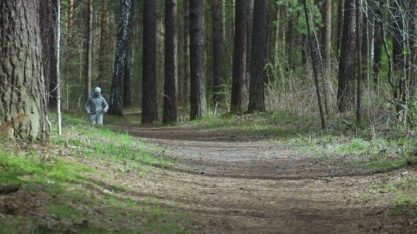 Thumbnail for Man Is Jogging At The Forest