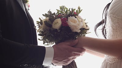 Couple Holding a Wedding Bouquet