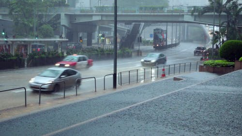 Downpour on the Streets of Hong Kong and Traffic