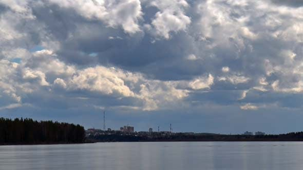 Cover Image for Clouds over City and River