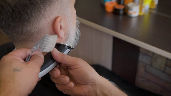 Thumbnail for Barber Trimming Beard To His Client