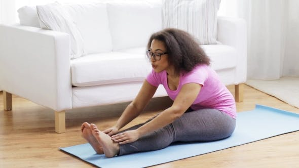 Thumbnail for Happy African Woman Exercising On Mat At Home 124