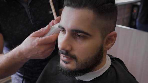Thumbnail for Barber Works With Clients Beard