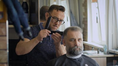 Gray-haired Man In a Barber Shop