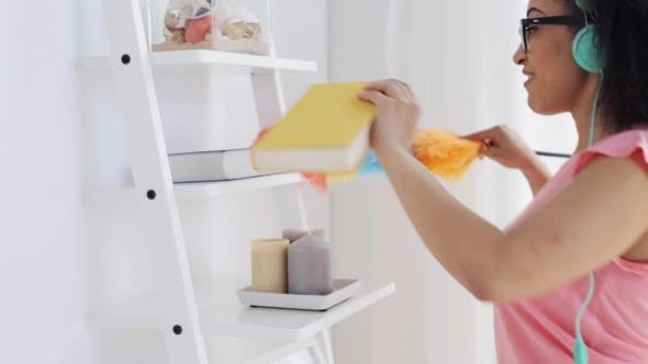 Thumbnail for Happy African Woman With Duster Cleaning At Home 48