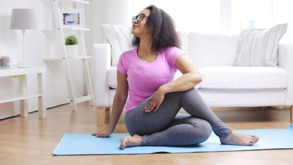 Thumbnail for Happy African Woman Exercising On Mat At Home 64