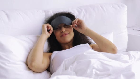 Thumbnail for African Woman With Sleeping Mask In Bed At Home 87