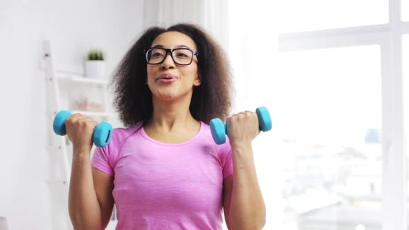 Thumbnail for African Woman Exercising With Dumbbells At Home 70