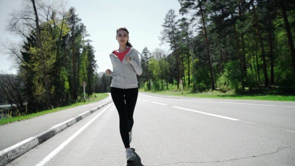 Thumbnail for Young Woman Jogging In Sunset