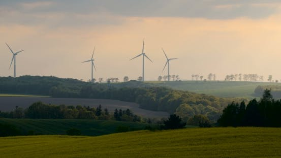 Thumbnail for Beautiful Windmill Turbines, Wind Energy Silhouetted In The Sunset.