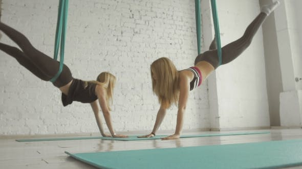 Thumbnail for Two Pretty Girls- Aerialist Doing Acrobatic Tricks On Aerial Silks