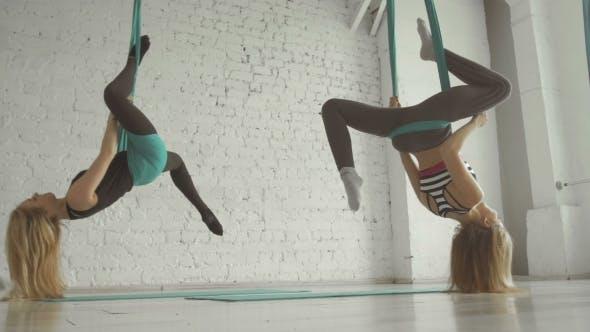 Thumbnail for Two Pretty Girls- Aerialist Doing Acrobatic Tricks On Aerial Silks