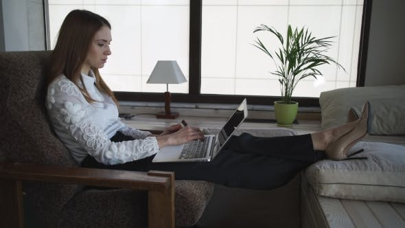 Thumbnail for Attractive Woman Buys Online With Credit Card And Computer.