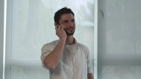 Thumbnail for Portrait Happy Man Talking On The Smart Phone Indoor