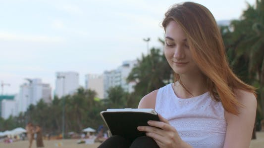 Thumbnail for Woman Enjoying Using Tablet on the Beach
