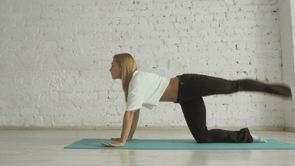 Thumbnail for Young Beautiful Yoga Posing On a White Brick Wall Background, Healthy Lifestyle