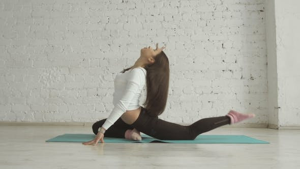 Thumbnail for Beautiful Young Woman Doing Yoga Exercise One-Legged King Pigeon Pose