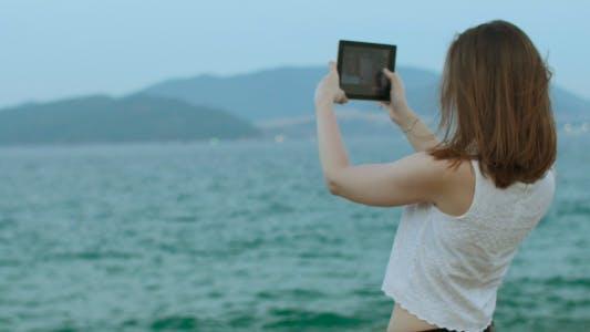 Thumbnail for Girl Doing Selfie with Tablet