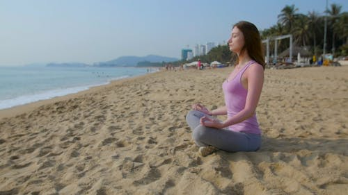 Woman Meditate  on the Beach in Slow Motion