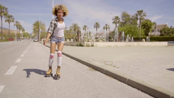 Thumbnail for Exotic Young Woman On Vintage Roller Skates