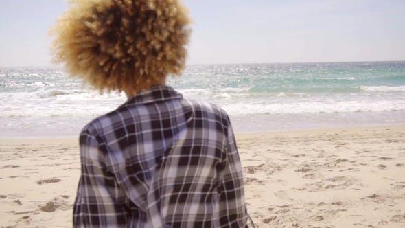 Thumbnail for Afro-American Woman Walks Beach Along