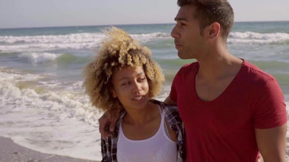 Thumbnail for Young Mixed-Race Couple On The Beach