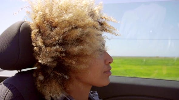 Thumbnail for A Young Black Woman Driving A Cabriolet In Summer