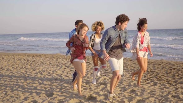 Thumbnail for Young People Running On The Beach