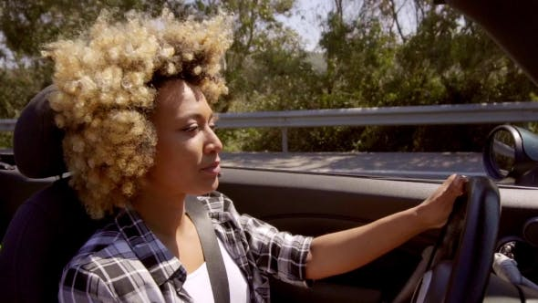 Thumbnail for Attractive Young African American Woman Driving