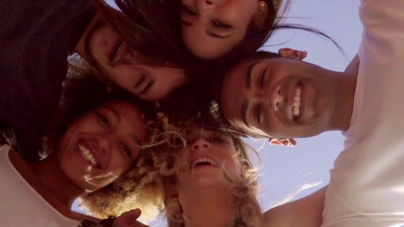 Thumbnail for Low Angle View Of Five Friends In a Huddle