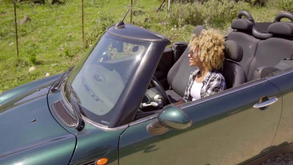 Thumbnail for Young Black Sexy Lady Driving The Car