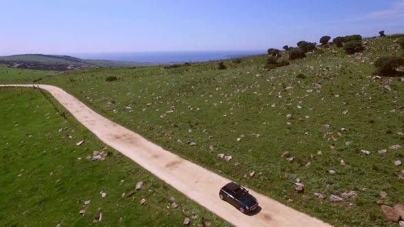 Thumbnail for Aerial Of The Hilly Road With Driving Lonely Car